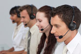 Attractive man with a headset on working in a call center — Stock Photo