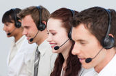 Beautiful woman working with other in a call center — Stock Photo