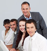 Business team working in a call center — Stock Photo