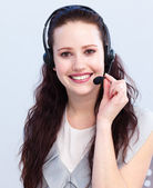 Smiling beautiful woman with a headset on — Stock Photo