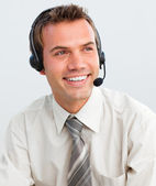 Attractive young businessman with a headset on — Stock Photo
