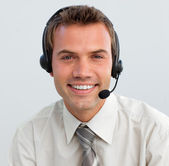 Portrait of a smiling businessman with a headset on — Stock Photo