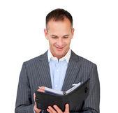 Self-assured businessman consulting his agenda — Foto de Stock