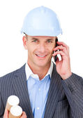 Self-assured male engineer talking on phone — Stock Photo