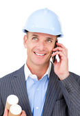 Cheerful male architect talking on phone — Stock Photo