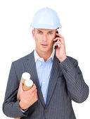 Stressed male engineer talking on phone — Stock Photo