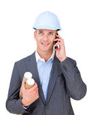 Smiling male engineer talking on phone — Stock Photo