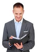 Arttractive businessman consulting his agenda — Photo