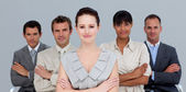 Confident multi-ethnic business team with folded arms — Stock Photo