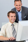 Mature manager checking his employee's work — Stock Photo
