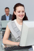 Smiling business working at computers — Stock Photo