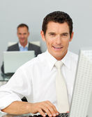 Confident businessman working at his computer — Stock Photo