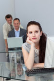 Bored businesswoman at her desk — Stock Photo
