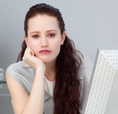 Close-up of a bored young businesswoman — Stock Photo