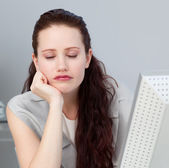 Close-up of a bored businesswoman sleeping at her desk — Stock Photo
