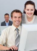 Charming businesswoman helping her colleague — Stock Photo