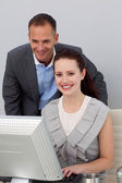 Charming businessman helping his colleague — Stock Photo