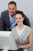 Business partners working at a computer — Stock Photo