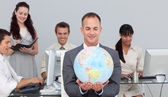 Charsmatic manager smiling at global expansion — Stock Photo
