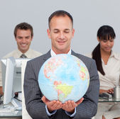 Assertive manager smiling at global expansion — Stock Photo