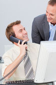 Businessman on phone talking to his colleague in the office — Stock Photo