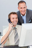 Businessman on phone and working with his colleague — Stock Photo