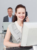 Businesswoman on phone and working in the office — Stock Photo