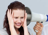 Portrait of a businesswoman getting nervous with a megaphone — Stock Photo