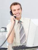 Businessman talking on phone in the office — Stock Photo
