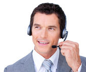 Confident young businessman using headset — Stock Photo