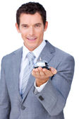 Smiling businessman holding a service bell — Stock Photo