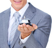 Close-up of a businessman holding a service bell — Stock Photo