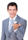 Assertive businessman showing a service bell — Stock Photo