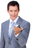 Attractive caucasian businessman showing a service bell — Stock Photo