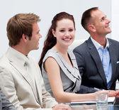 Beautiful businesswoman smiling in a meeting — Φωτογραφία Αρχείου
