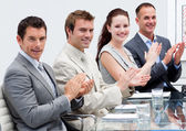 Business team applauding in a meeting — Stok fotoğraf