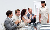 Businessman applauding a colleague after giving a presentation — Stock Photo
