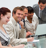Young businessman working with his team — Stock Photo