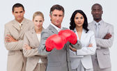 Confident businessman boxing and leading his team — Stock Photo