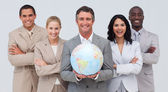 Team di business tenendo un globo terrestre — Foto Stock