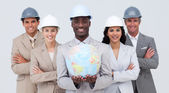 Architectural team holding a terrestrial globe — Stock Photo