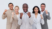 Happy and positive business team standing and smiling — Stock Photo