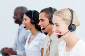 Portrait of smiling business working in a call center — Stock Photo