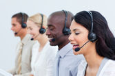 Multi-cultural business working in a call center — Stock Photo
