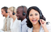Attractive businesswoman and her team working in a call center — Stock Photo