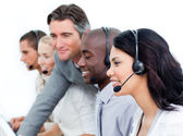 Charismatic manager and his team working in a call center — Stock Photo