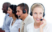 International business team talking on headset — Stock Photo