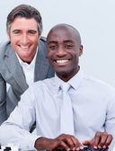 Smiling mature businessman helping his colleague — Stock Photo