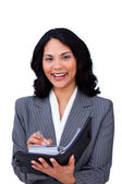 Charming businesswoman making notes on her agenda — Stock Photo