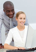 Ethnic businessman and his colleague working at a computer — Stock Photo
